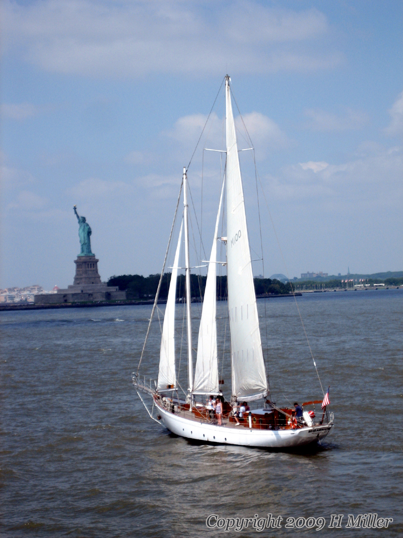 "Statue Of Liberty And Sailboat. Picture-perfect NYC. Hotel Massage NYC.  In-Room Relaxation. Keep Up With NYC During Your Stay. â""¢"